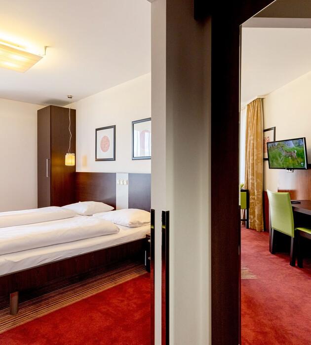 Ein gemütliches Zimmer im Hotel für Incentives und Firmenevents in Kärnten